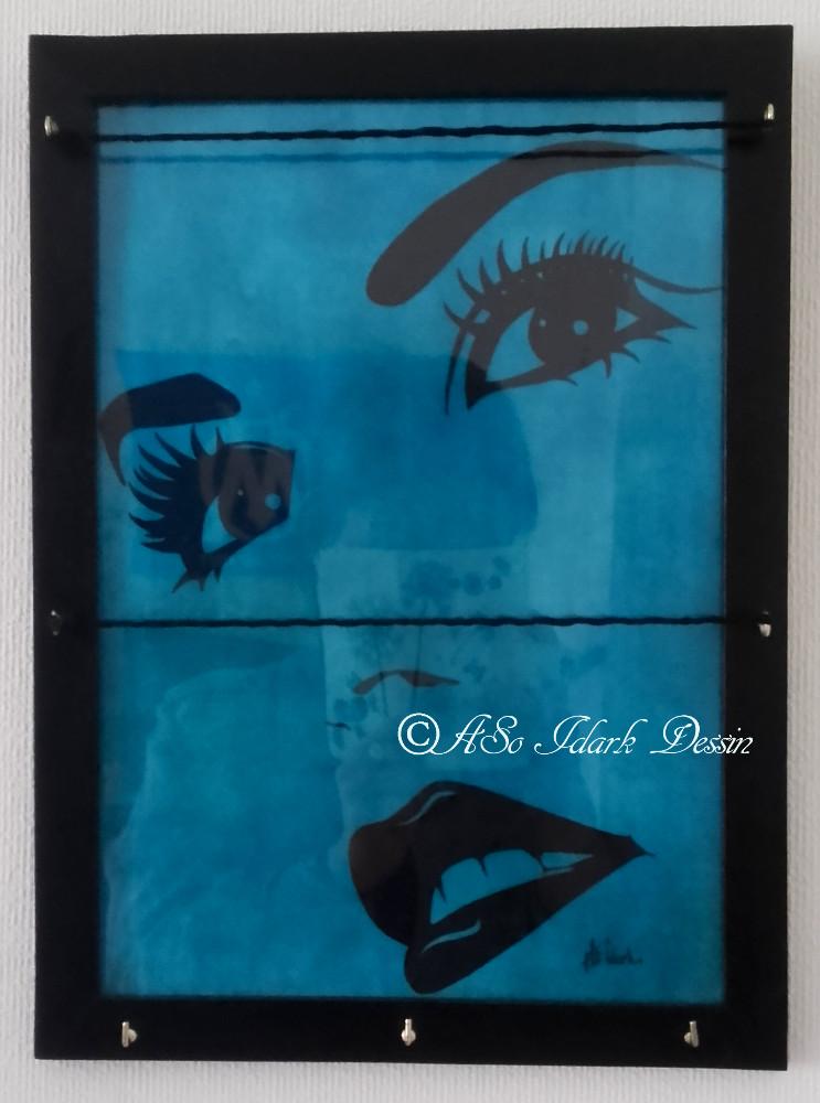 Bijoux Phosphorescent 1042 a tableau à bijoux ou a memo phosphorescent bleu et noir visage