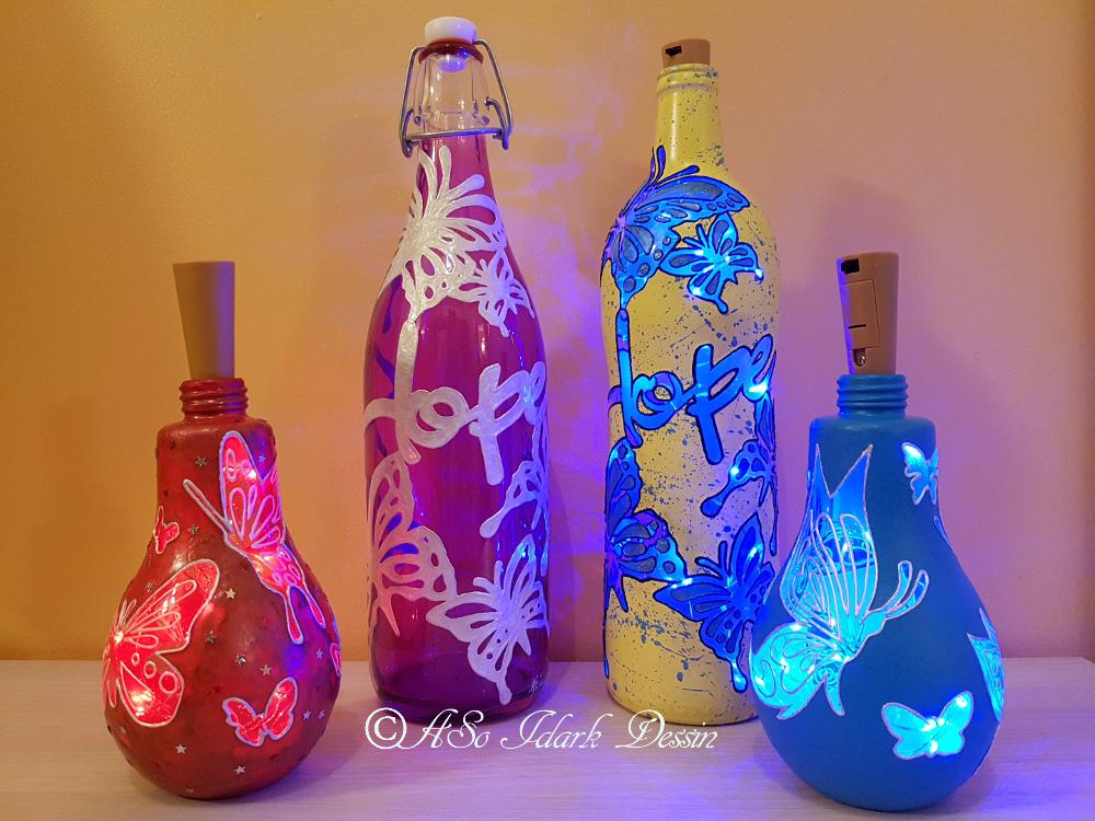 Déco sur vinyles, horloges, ampoules et bouteilles lumineuses peintes à la main